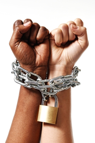 White Race Hand Chain Locked Together With Black Ethnicity Woman
