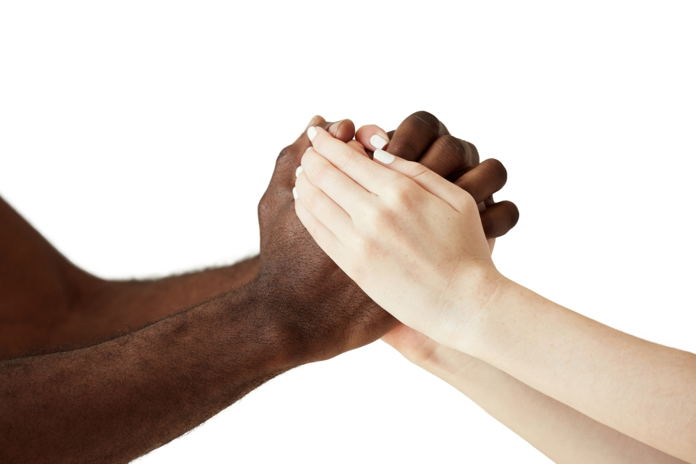White Caucasian Woman And Black African Man Holding Hands In Cor